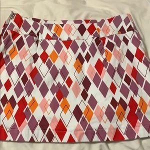 Shortened golf skirt. Size 4